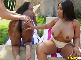 Layton Benton and yoke less oiled ebony share friend's penis in the garden
