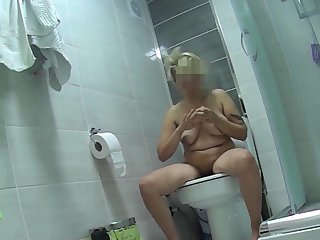 Short thorn tattooed blonde pissing on touching wc