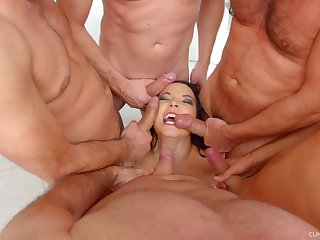 MILF Belle Francys on her knees getting mouth fucked by a couple of men
