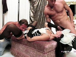 Stimulated woman handles two males in a serious trio