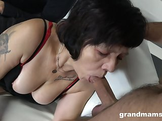 Several sex-starved guys fuck mouth and pussy of whore granny in red stockings